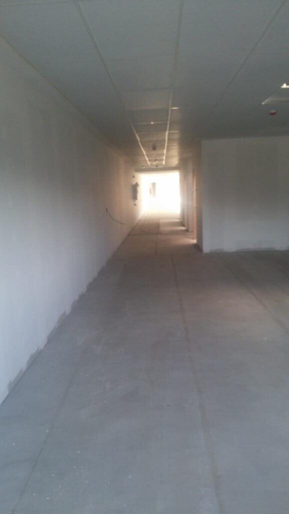 Repinor Microcemento Oficina Industria Farmaceutica Santander 4 579x1030 santander torrelavega